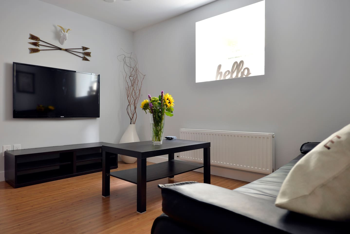 """Living room with 50"""" HDTV, local HD channels, and a Chromecast in case you'd rather play your own Netflix, HBO, Hulu, or just watch YouTube on the big screen."""