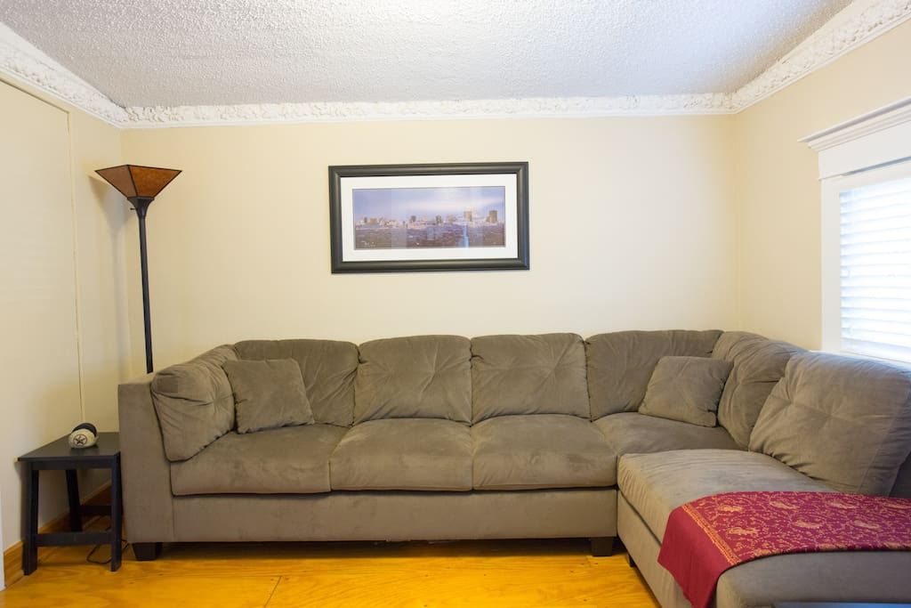 Living room comfy suede sectional couch signed print of Austin's skyline