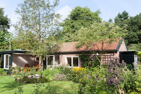 Our garden house provides everything for a lovely stay on the natural area of the Veluwe near the city of Arnhem. Situated at the edge of Park Warnsborn, near the National Park Hoge Veluwe and about 10 minutes of the city centre.  The garden house is suited for 2 persons and with full amenities: kitchen with gas cooker, refrigerator, dish washer and oven/microwave, separate bathroom with shower and toilet, living/sleeping area with 2 comfortable beds. A garden and free car parking are available.
