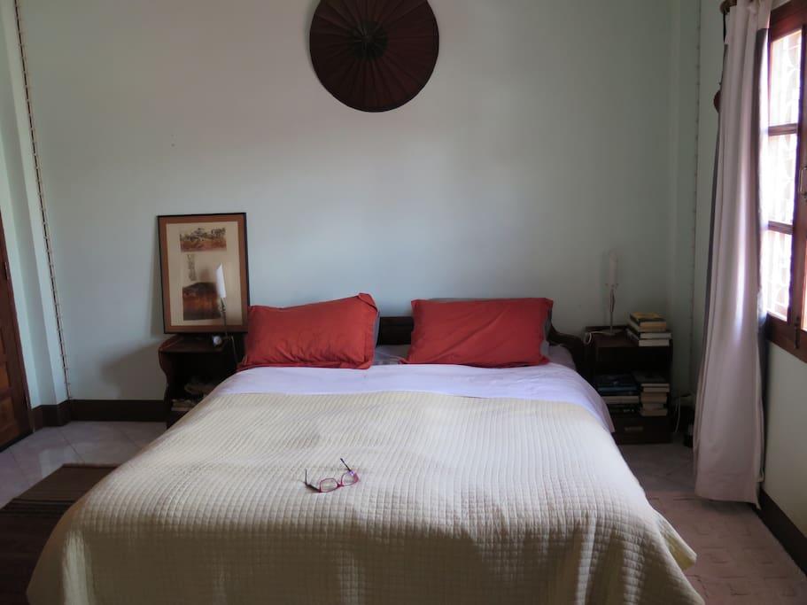Spacious main bedroom, with kingside bed, ensuite bathroom