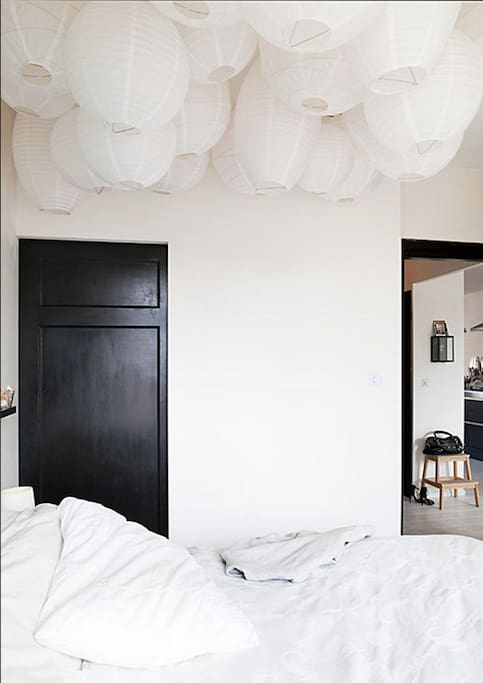 The bedroom with a paper lamp ceiling