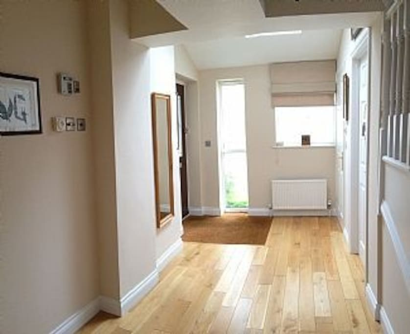 Large hallway with walk in cloakroom with storage and bathroom