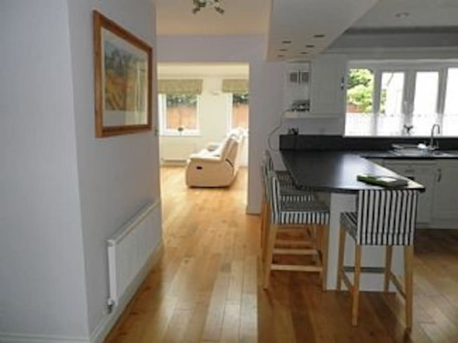 Large open plan kitchen leading to lounge