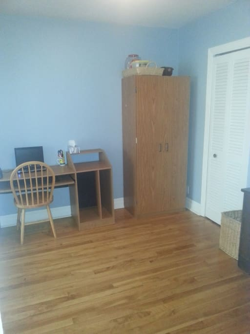 Other side of the double room with a desk