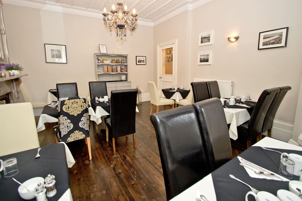 Our elegant dining room where we serve a full English breakfast along with cereals, fresh fruit, toast, local jams & marmalade.