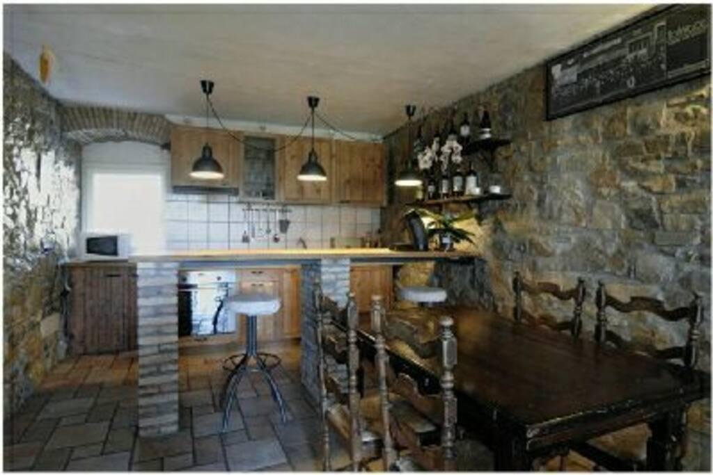 La sala e la cucina dell'appartamento Giulietta e Romeo