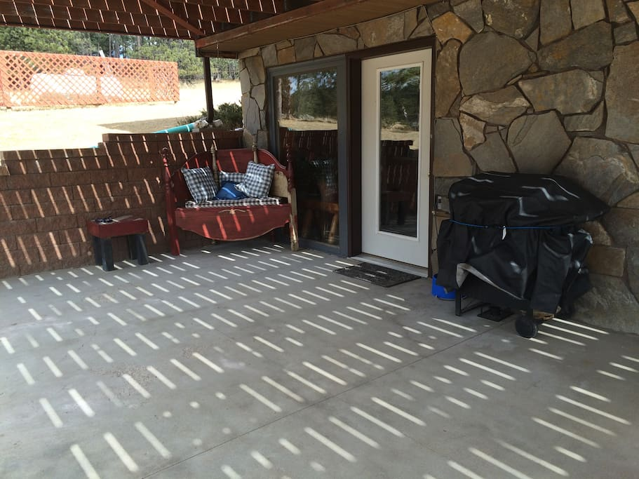 Patio and entrance along with grill available for use