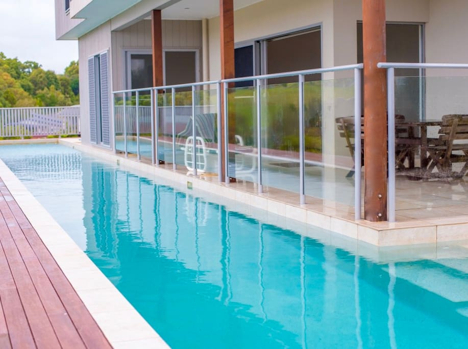 Self Contained Bottom Section of House Running Along Beside the 25m Lap Pool with large balcony.