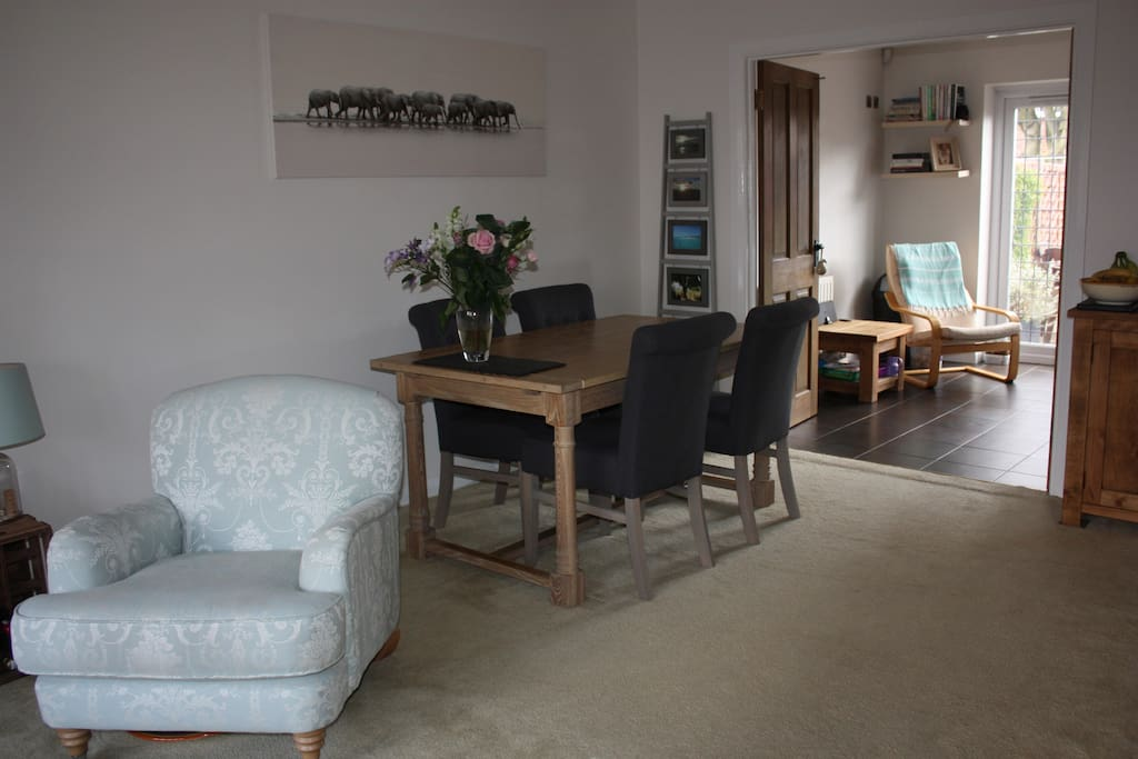 Dining area in the living room; easy access to the kitchen. Table seats 6 or can be extended to seat up to 10.