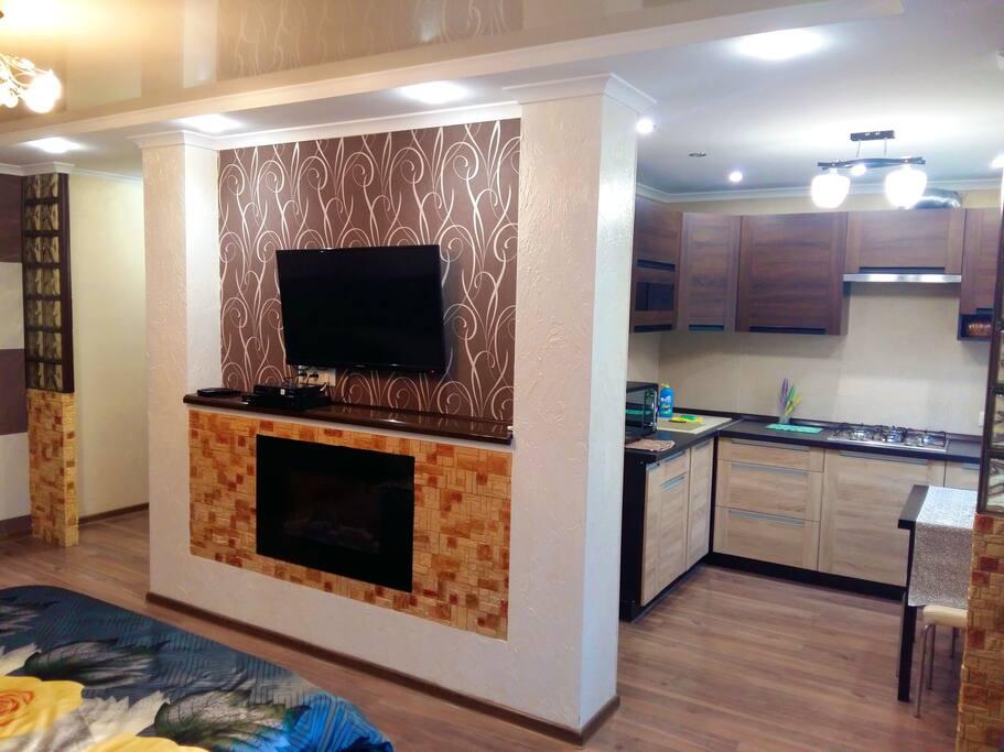 Chocolate Apartment - просторная студия с полноценной кухней
