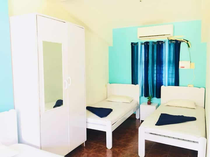 Group room with 4 single beds & attached bathroom