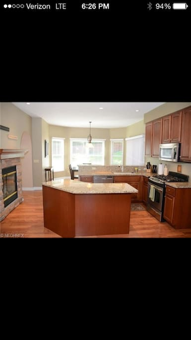 Granite tops and stainless steel appliances fill the open kitchen and dining area!