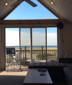 Live on the beach in this Adorable relaxing Beachfront  upper level one bedroom chalet, with amazing direct ocean views.