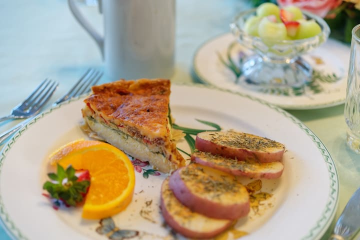 Typical breakfast - quiche Lorraine with grilled potatoes