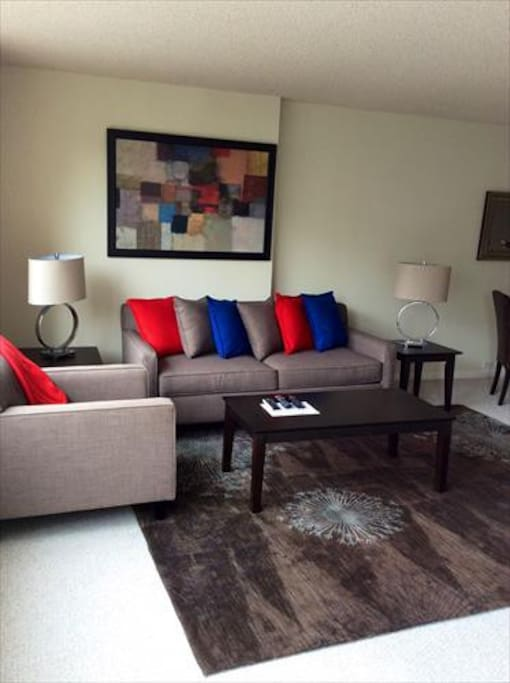 Comfortable and spacious living room with pullout sofa bed and club chair