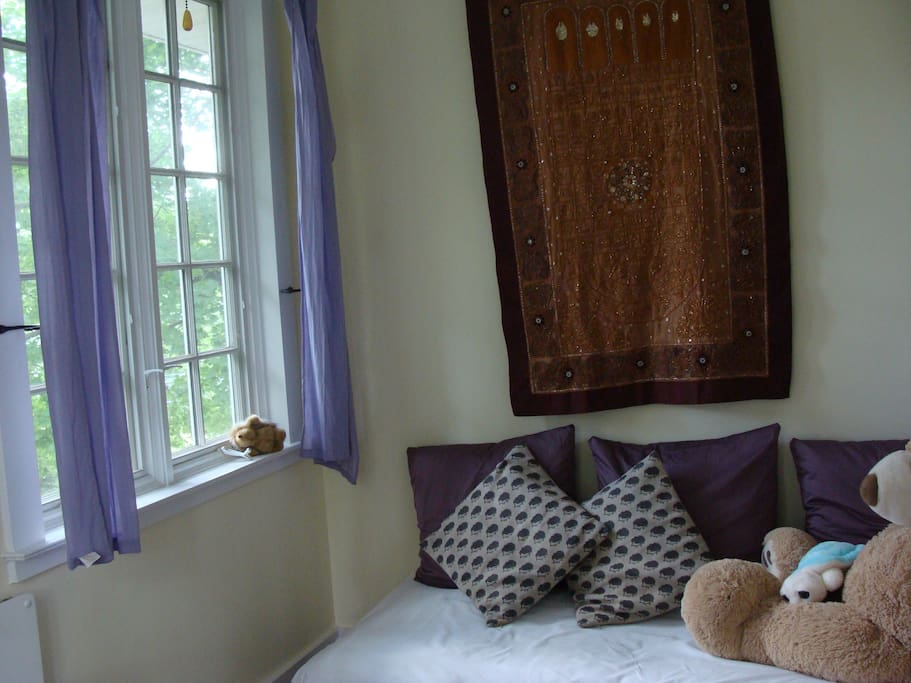 The daybed/couch in the attached sunroom/study