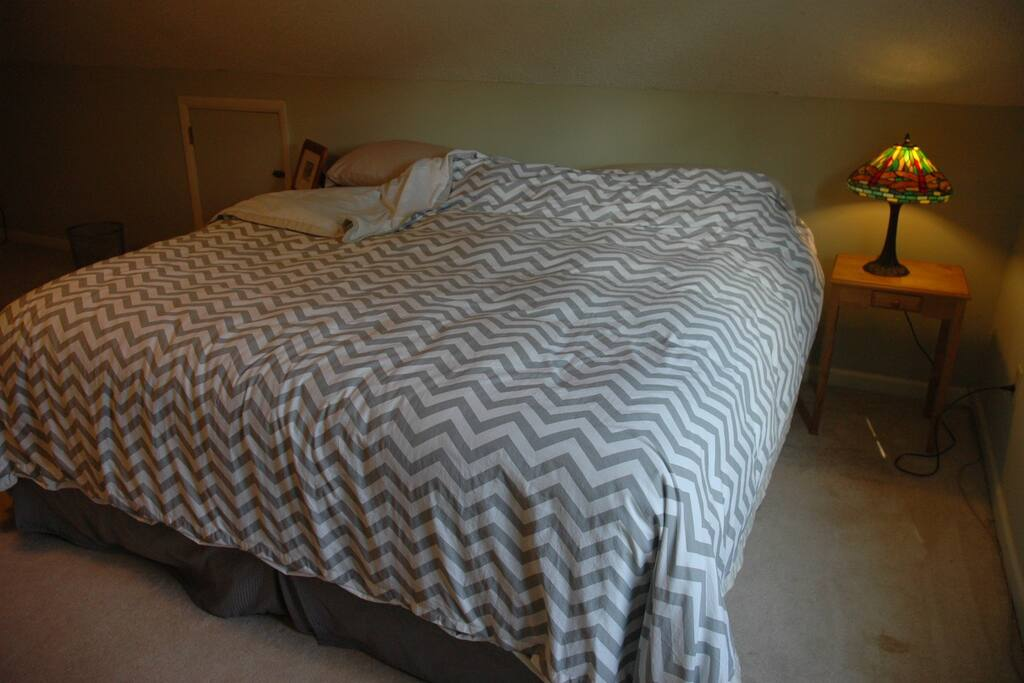 King size bed with all duvet and all cotton sheets.