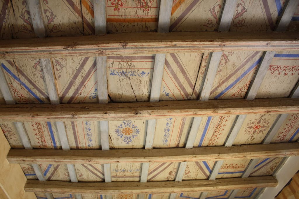 the wooden painted ceiling