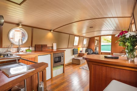 Luxury houseboat on private mooring