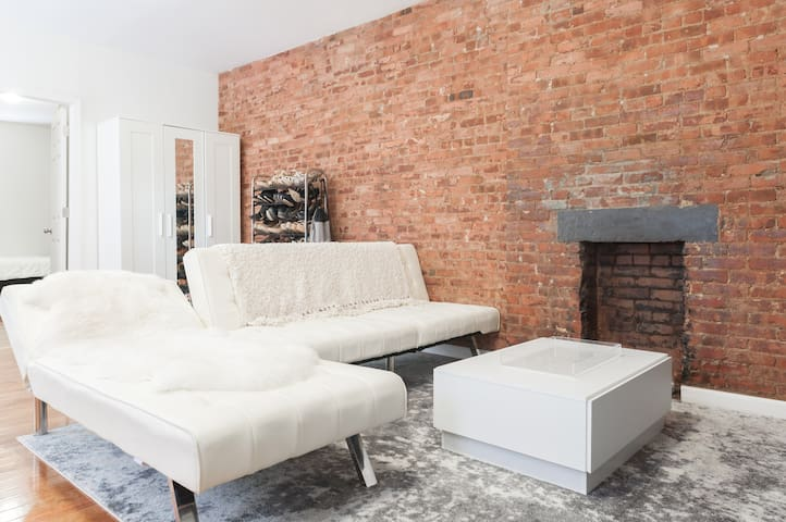 Cozy Room with Exposed Bricks