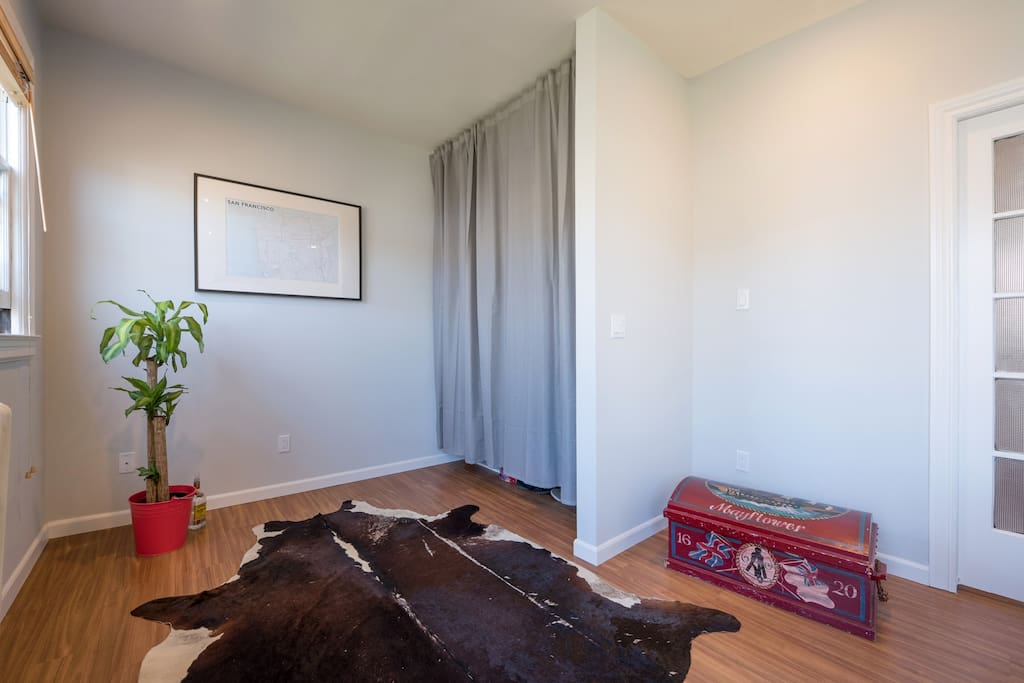 Spacious bedroom with cow skin rug