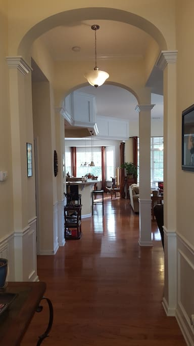 Foyer leads to stairs on the left and the great room straight ahead.
