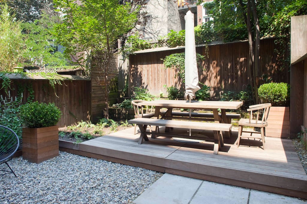 Garden with seating for outdoor dining.
