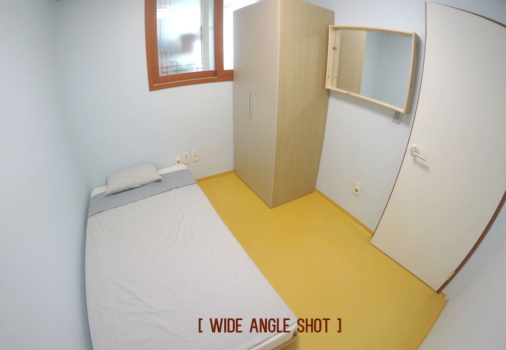 This is a wide-angle shot of the room. You have a comfortable bed, a wardrobe and a mirror. We'll provide you with more bedsheets and fresh towels. The room is not big, but big enough for one person to have a relaxing stay.