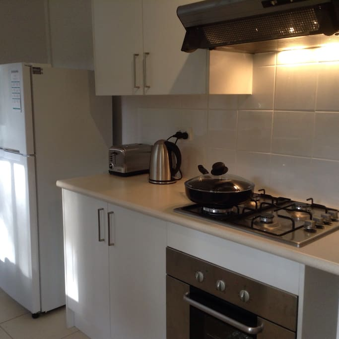 Full modern kitchen  with stovetop,oven and microwave.