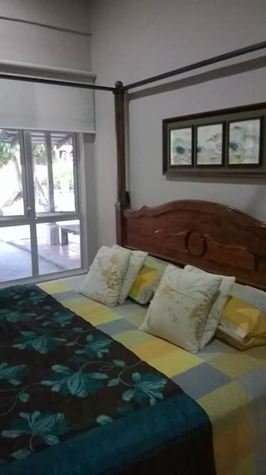 Master bedroom.  King size bed and air conditioning.