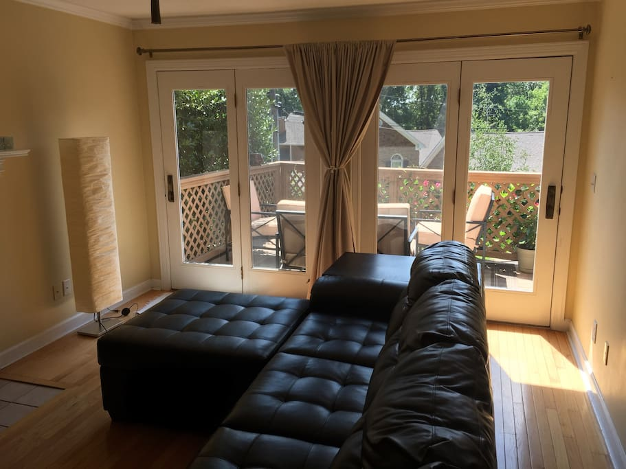Sectional partial leather couch that is new, comfortable and spacious for good rest. The curtains can cover the glass doors to the patio. In the day, can be used to hang out.