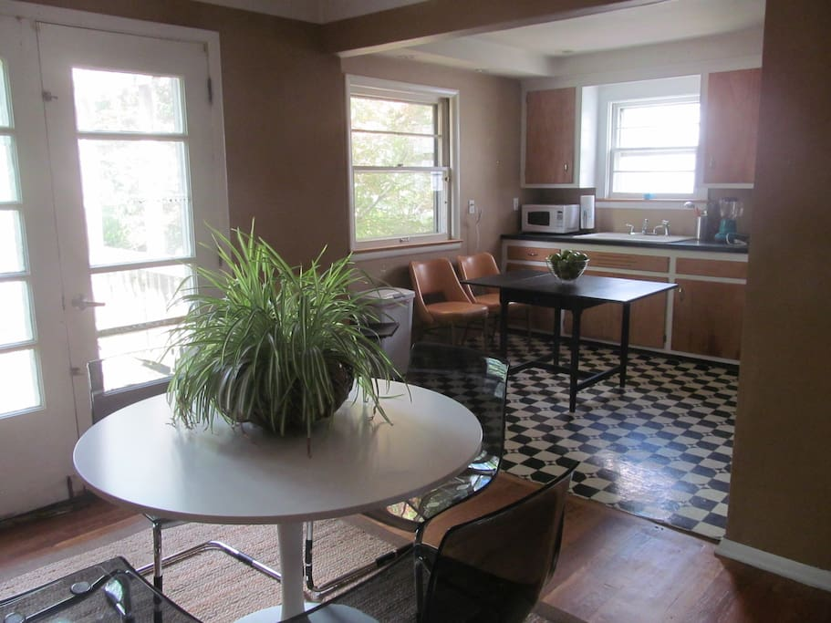 Cool Dining Room and Kitchen with appliances.