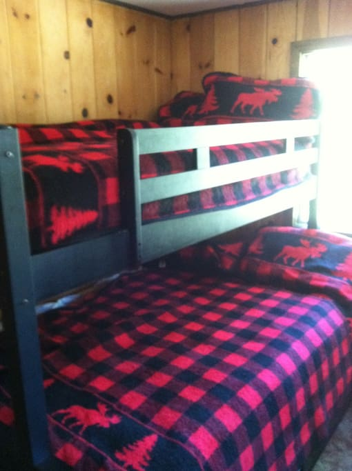 Kids bedroom with a full and two twin beds one above and one below