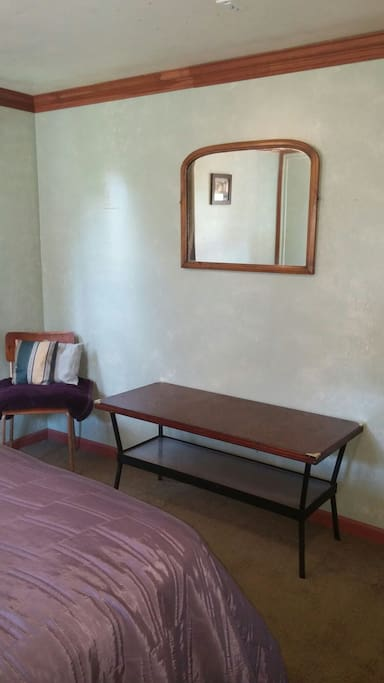 Seating and table in queen bedroom.