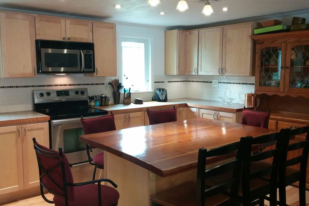 Full kitchen with stove, oven, microwave, refrigerator, dishwasher, toaster and coffee maker.  Cupboards are stocked with cups, plates silverware etc.  Large bar height table and customizable lighting.