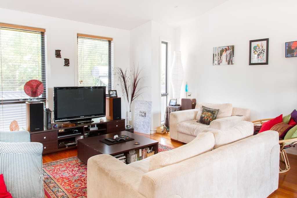 large couches and TV perfect for undwinding