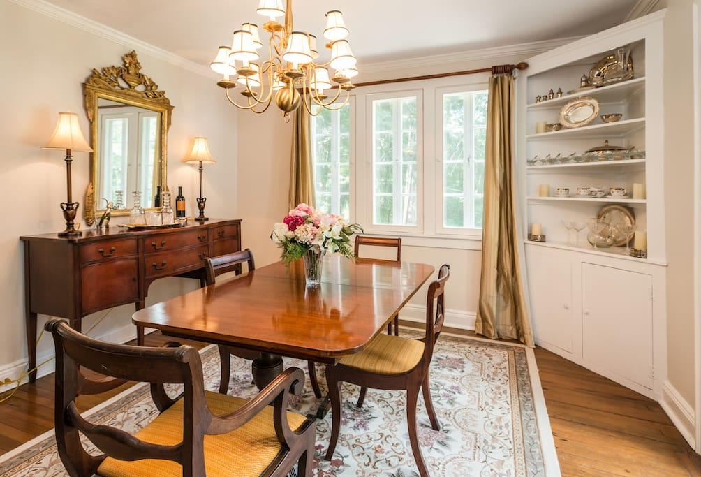 The dining room with a beautiful table that accommodates up to 8 chairs. This dining room leads to a small porch.