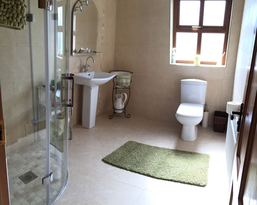 Large adjoining bathroom with power shower