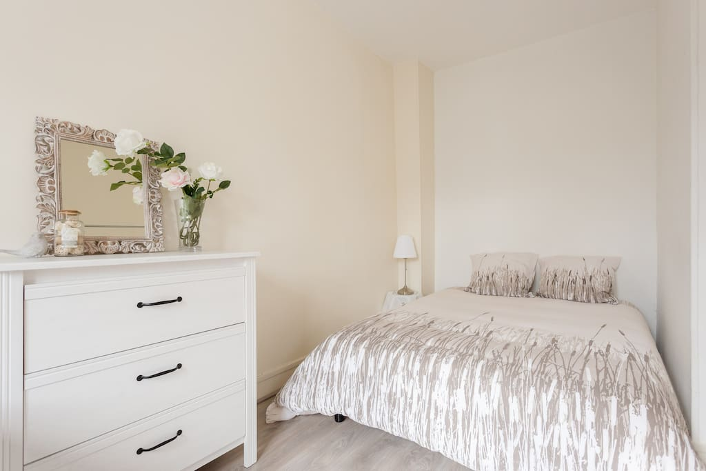A super comfortable double bed with clean bedclothes.