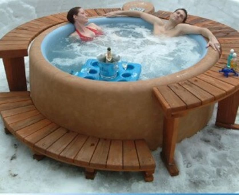 Similar tub to what we have on the deck.  Now with a partial privacy fence!