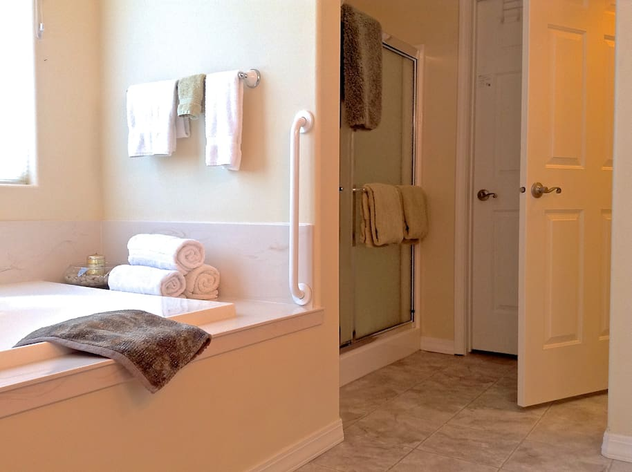 Large private bath. Walk-in shower, private stall, double vanity sinks and whirlpool tub!