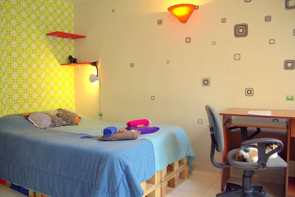 Your room! A luminous room, semi-double bed, enough space for luggage and a desk.
