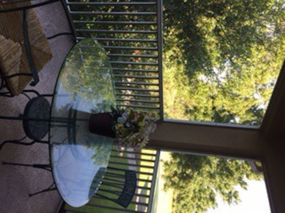 Table and 4 chairs on main unit screened in patio