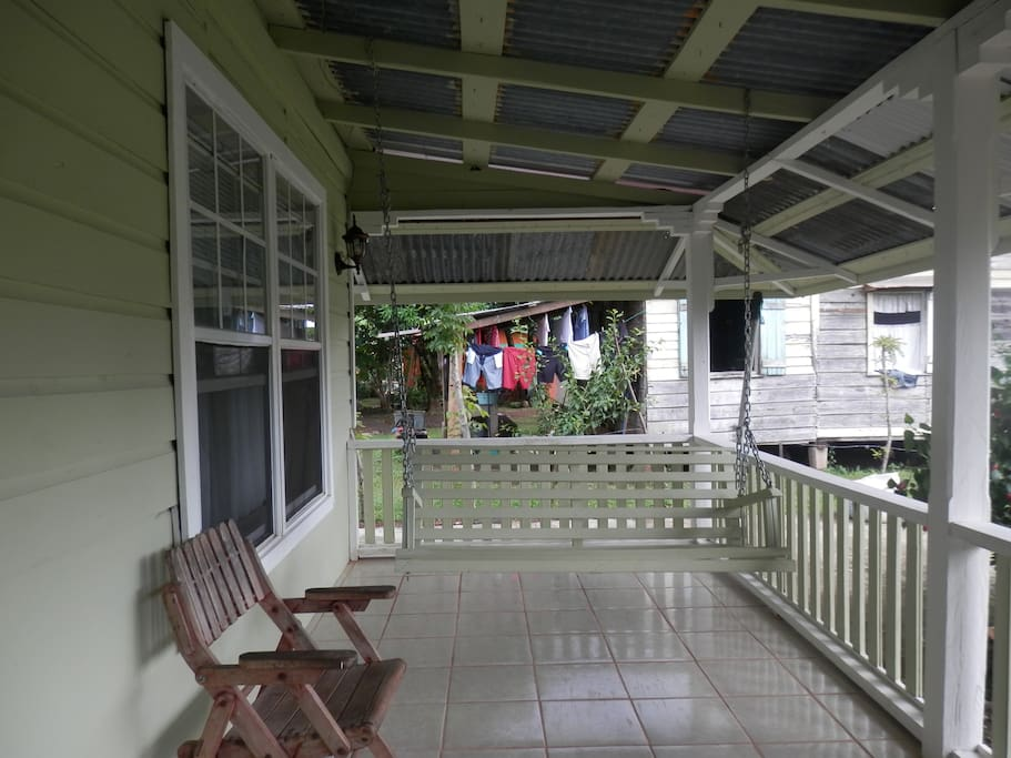 Front porch with swing seater for 3 persons.