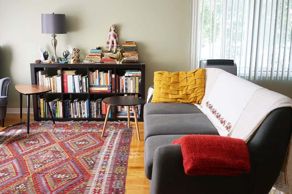 Cozy couch and books.