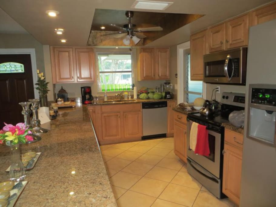 Kitchen with dishwasher and eat-in breakfast bar at our Florida rental.