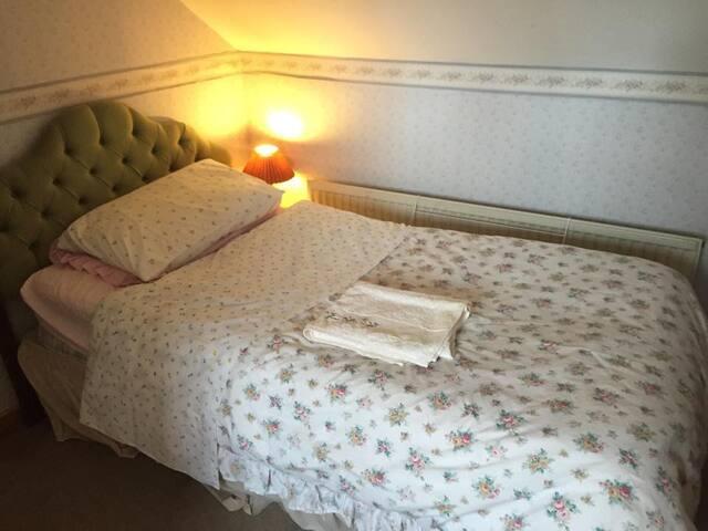 corner of single bedroom.