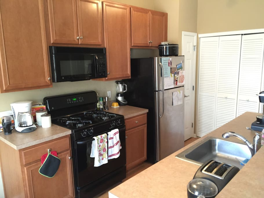 Well-lit kitchen with all appliances, coffee and breakfast available. Breakfast nook and laundry closet off of kitchen.