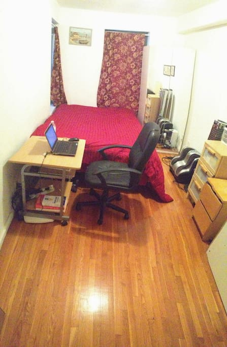 Large bedroom with an office space