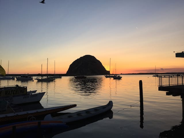Morro Rock, August Sunset. This view is not from my home but from the embarcadero, approximately 10 blocks away.